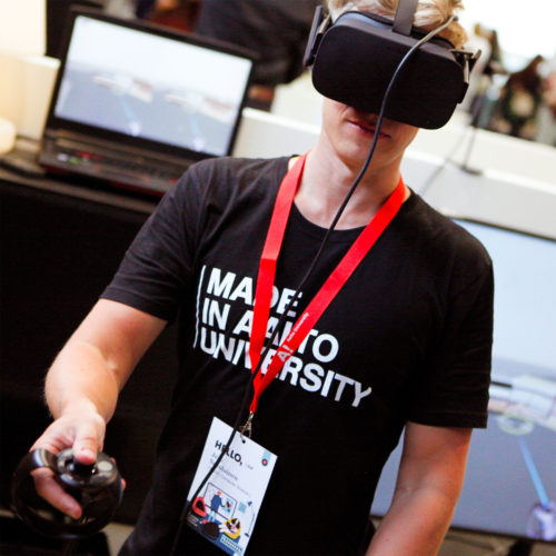 Front view of an Aalto University student using a VR headset.