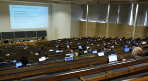 Students taking an exam in an auditorium.